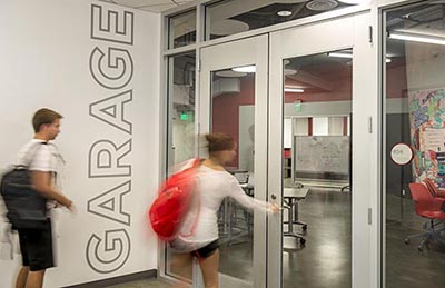 Students enter the Academy Garage